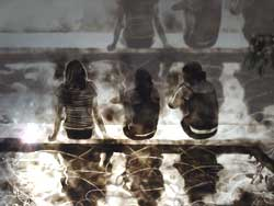Jeffrey Aaronson photo of reflection of three women